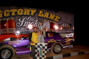 Robbie Comer and family in victory lane at 411 in 2013.