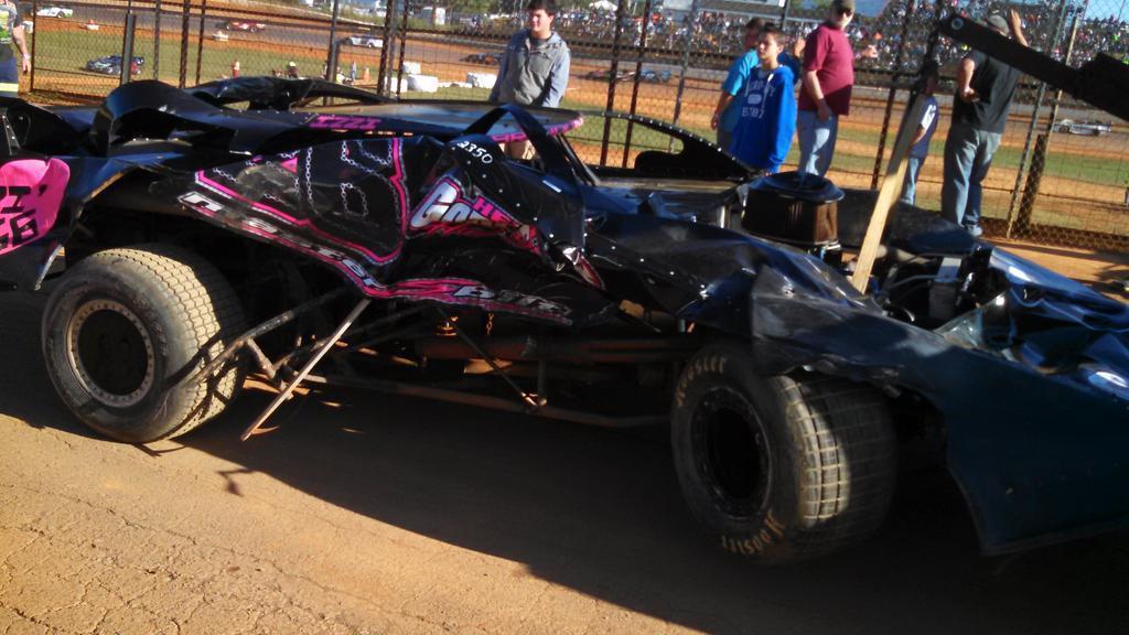 The badly damaged machine of Brandon Gardner is towed off track after a lap 1 crash