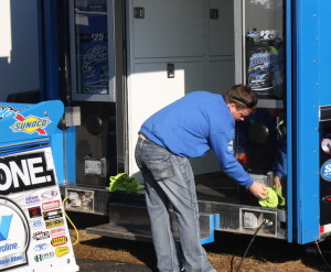 The Rocket team put Brandon Sheppard to work cleaning the hauler.