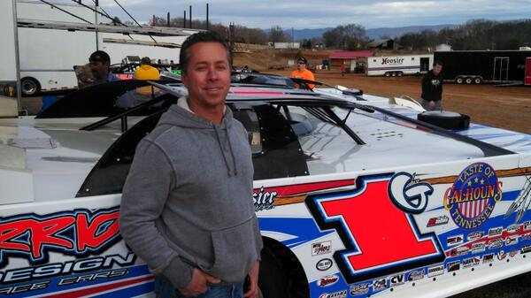 Rick Eckert beside the Warrior House car he will drive over the next two weekends.