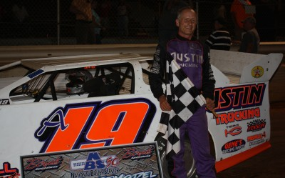 Ronnie Johnson with the checkered flag in Boyd's Victory Lane.