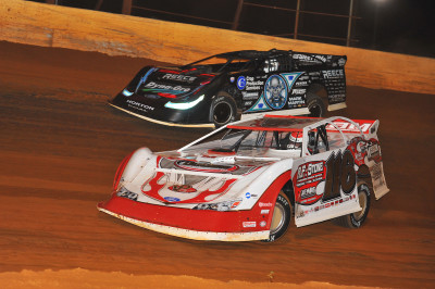 Randy Weaver(116) passes by Scott Bloomquist on his way to a Lucas Oil win at Smoky Mountain.