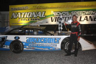 Ronnie Johnson in Boyd's victory lane in the Brucebilt car