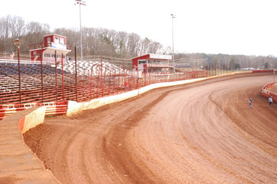The front stretch and grandstands of Atomic Speedway.